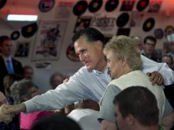 Mitt Romney greets supporters during a campaign stop at Charlie Parker's Diner in Springfield, Ill.