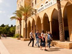 Students walk through the American University of Beirut campus. As uprisings toppled governments and led to crackdowns in nearby countries, the Lebanese capital remained relatively calm.