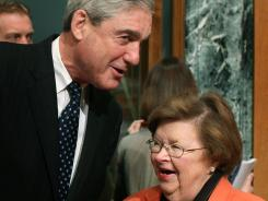 FBI Director Robert Mueller talks with Sen. Barbara Mikulski before a Senate Appropriations Committee hearing March 15 on Capitol Hill.