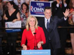 Mitt Romney and his wife, Ann, greet supporters after the close of voting for the Illinois primary Tuesday in Schaumburg, Ill.