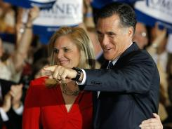 Mitt Romney and his wife, Ann, appear at a primary night rally in Schaumburg, Ill., on Tuesday night.