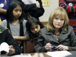 Sisters Laisha and Yoselin Mendoza listen with Rep. Becky Currie during a meeting on legislation Feb. 22 in Jackson, Miss.
