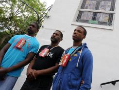 Devin Girtman, left, Curtis Woods and Daniel Byers wear Skittles candy boxes Wednesday in support of Trayvon Martin, an unarmed teen who was shot to death as he walked through a gated community after buying Skittles at a nearby 7-Eleven.
