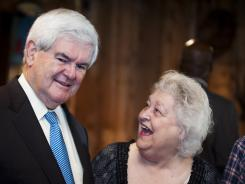 Hazel Boudreaux of Houma, La., laughs at a joke made by Newt Gingrich Thursday at Big Al's Seafood Restaurant in Houma.