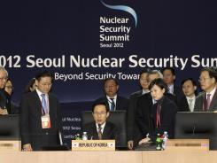 South Korean President Lee Myung Bak sits in the chairperson's seat at the 2012 Seoul Nuclear Security Summit Thursday.