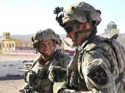 Army Staff Sgt. Robert Bales, left, trains on Aug. 23 at Fort Irwin, Calif.