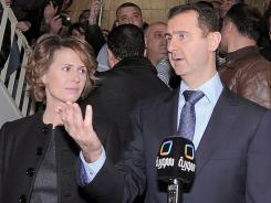 Syrian President Bashar Assad and his wife, Asma, in Damascus on February 26.