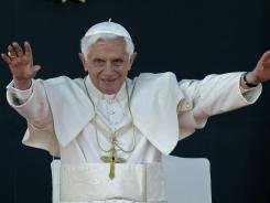Pope Benedict XVI waves upon his arrival at the airport in Silao, Mexico, on Friday.