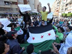 Anti-Syrian regime protesters chant slogans against Syrian President Bashar Assad during a demonstration March 23.