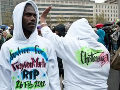 People attend Saturday's demonstration in Washington to demand justice for Trayvon Martin.