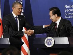 President Obama shakes hands with South Korean President Lee Myung-bak during their joint news conference Sunday in Seoul.