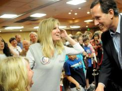 Rick Santorum shakes hands, signs autographs and takes photos with supporters at his pep rally Friday in Shreveport, La.