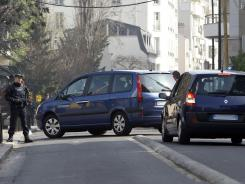 Cars with their registration plates covered with tape transfer passengers believed to be Abdelkader Merah and his companion to the French police's anti-terrorist headquarters Saturday near Paris.