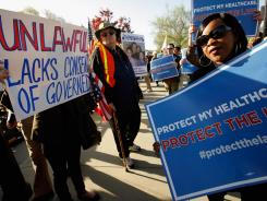Demonstrators for and against the health care law gather Monday outside the Supreme Court in Washington.