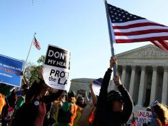 Supporters of President Obama's health care overhaul law march outside the Supreme Court in Washington on Monday.