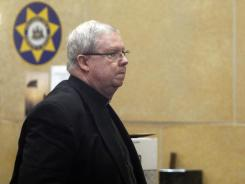 Monsignor William Lynn arrives for the start of his trial Monday in Philadelphia.
