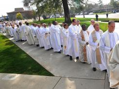 Clergy wait to attend a mass in Fresno, Calif., in February. A new survey asks Catholics why they have stopped attending mass.
