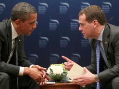 President Obama speaks with Russia's leader Dmitry Medvedev in Seoul on Monday.
