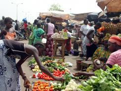 People shop at a market Sunday in Bamako, Mali.