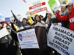 Rep. Michele Bachmann, R-Minn., addresses Tea Party supporters and opponents of the health care overhaul Tuesday in front of the Supreme Court.
