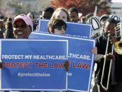 Supporters for the health care reform law rally in front of the Supreme Court on Monday.