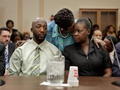 Rep. Sheila Jackson Lee embraces Sybrina Fulton, right, and Tracy Martin, Trayvon Martin's parents, during a House Judiciary Committee briefing Tuesday on Capitol Hill.
