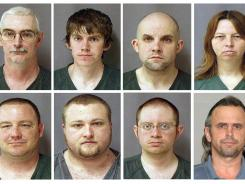 Tied to Hutaree: David Stone Sr., top left, David Stone Jr., Jacob Ward, Tina Stone, Michael Meeks, bottom left, Kristopher Sickles, Joshua Clough and Thomas Piatek. Clough is the only defendant to make a deal with prosecutors and did not face trial on charges of planning to start a war on the government. The other seven were acquitted on key charges Tuesday.