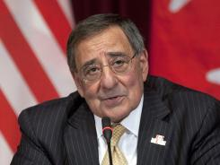 Defense Secretary Leon Panetta responds to questions during Tuesday's news conference after meetings in Ottawa.