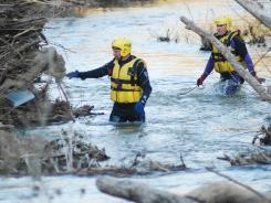 Marion County Emergency Search and Rescue Swift Water Rescue Technicians Anton Such, left, and Dwayne McFarland search for 4-year-old Caleb Linn on Monday.