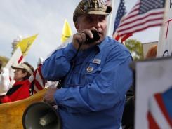 "Gregg Cummings shouts, ""Liberty not tyranny,"" on Wednesday in front of the Supreme Court. He traveled from Lamont, Iowa."