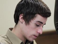 T.J. Lane signs papers during court proceedings March 6 in Chardon, Ohio.