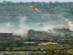 This image made from amateur video and released by Ugarit News on Wednesday purports to show smoke from shelling in Idlib, Syria.