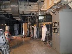 In this photo taken and released on Tuesday by Tokyo Electric Power, workers measure radiation at the the tsunami-crippled Fukushima Dai-ichi power plant.