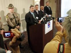 Vermont State Police Major Ed Ledo, center, speaks during a news conference Wednesday in St. Johnsbury, Vt.