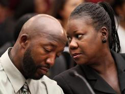 Trayvon Martin's parents, Tracy Martin, left, and Sybrina Fulton, attend a House Judiciary Committee briefing on racial profiling and hate crimes Tuesday on Capitol Hill.