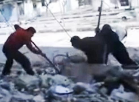 Amateur video released Friday purports to show Syrians pulling the body of a ...