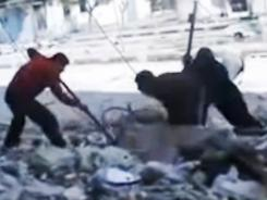 Amateur video released Friday purports to show Syrians pulling the body of a man out from under the rubble of a building that was bombed in Homs.