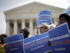 Supporters of health care reform rally in front of the Supreme Court on Wednesday.