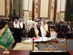 Saudi Arabia's Ahmad al-Qattan, center, attends the Arab League summit in Baghdad on Thursday. Only 10 of the league's 22 leaders attended.