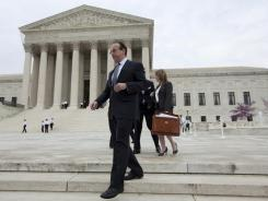 Paul Clement, a lawyer for 26 states seeking to have the Patient Protection and Affordable Care Act tossed out in its entirety, leaves the Supreme Court on Wednesday.