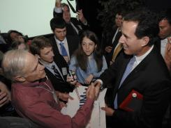 Rick Santorum greets Lee Spangler after speaking Saturday at the Pennsylvania Leadership Conference in Camp Hill, Pa.