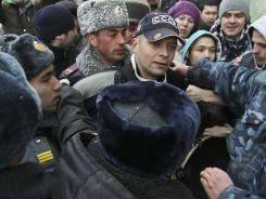 Officers disperse a group of protesters rallying in Kazan, Russia, on March 18 against the torture of detainees by local police.