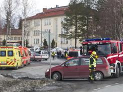 Emergency vehicles stand outside a secondary school in Orivesi, Finland, where a gunman was arrested after firing several shots.