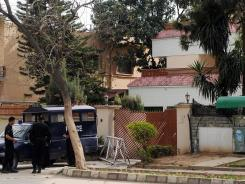 Pakistani security personnel stand guard outside the house where family members of slain Al-Qaeda chief Osama bin Laden are believed to be held, in Islamabad on Friday.
