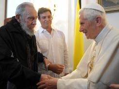Pope Benedict XVI meets with former Cuban president Fidel Castro at the Vatican embassy in Havana on Thursday.