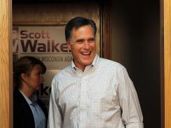 Republican presidential candidate Mitt Romney greets volunteers at a phone bank for Wisconsin Gov. Scott Walker on Saturday in Fitchburg, Wis.