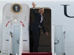 President Obama waves before his departure Friday in Burlington, Vt.