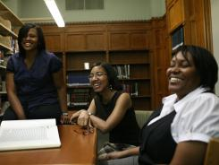 In this June 2009 photo, doctoral students in the Graduate Department of Religion at Vanderbilt University meet to study in Vanderbilt's Divinity Library in Nashville. From left, Lisa Thompson, Monique Moultrie and Amy Steele.