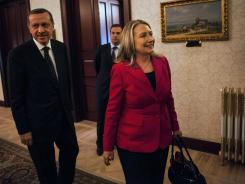 U.S. Secretary of State Hillary Clinton leaves after a meeting Sunday with Turkey's Prime Minister Recep Tayyip Erdogan at Dolmabache Palace in Istanbul.