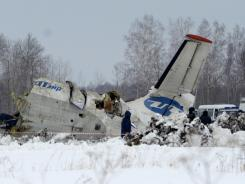 Russian Emergency ministry rescue workers search the site of the ATR-72 plane crash on Monday that killed 31 people outside Tyumen, a major regional center in Siberia, Russia.